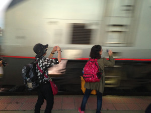 Japanese tourists capturing images of the train approaching.